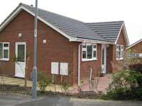 side elevation bungalow in rear garden