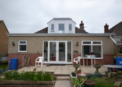 Loft conversion with dormer windows at Winslow Road