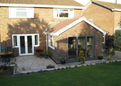 Single storey rear extension to create a lounge at Budmouth Avenue