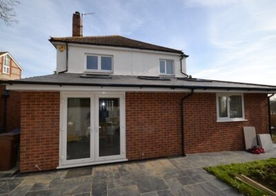 Single storey rear extension creating new kitchen, dining room and attached garage at Coniston Crescent