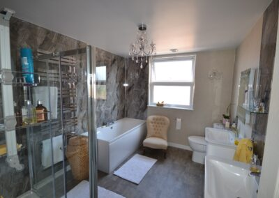 Internal view of first floor bathroom of completed two storey lounge, utility room and bedroom extensions