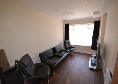 Internal view of completed two storey extension creating lounge, utility and bedroom with en suite bathroom