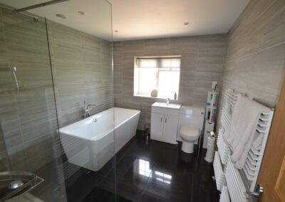 Internal view of en suite bathroom of completed two storey extension creating lounge, utility and bedroom with en suite bathroom