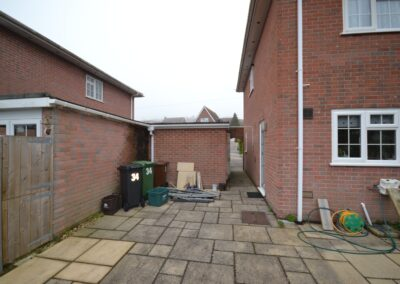 Rear view prior to construction of completed two storey extension creating lounge, utility and bedroom with en suite bathroom