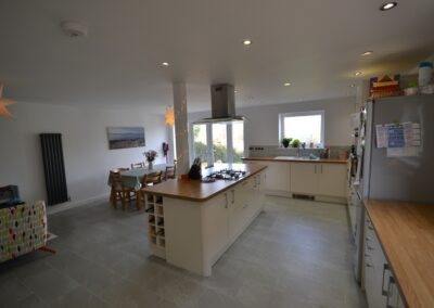 Internal view of completed kitchen and dining room of two storey kitchen, dining room and bedroom extension